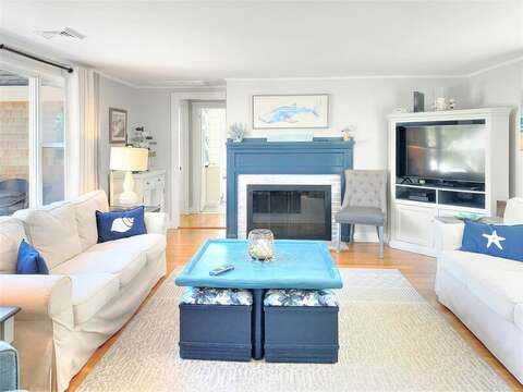 Find coastal comfortable furnishings in the living room along with a flat screen TV. - 25 Grey Neck Road West Harwich Cape Cod - New England Vacation Rentals