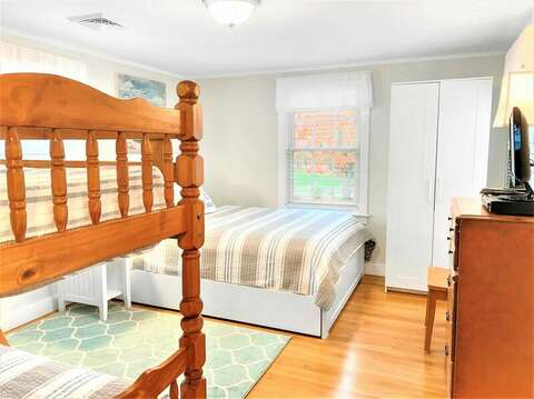 Bedroom 2 with a Queen bed and bunk beds - 25 Grey Neck Road West Harwich Cape Cod - New England Vacation Rentals
