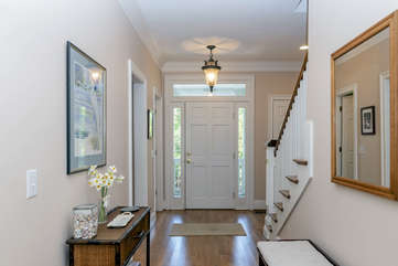 Enter into a bright foyer, which leads to the open living area.