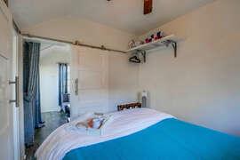 Barn door in bedroom for extra privacy.