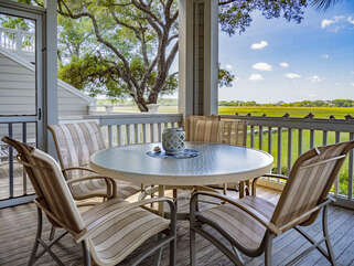 Enjoy the amazing marsh views from the screened porch