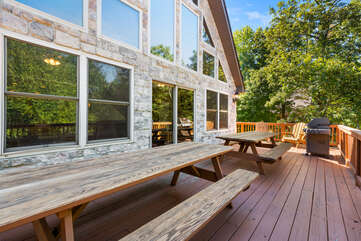 outdoor porch with two picnic tables