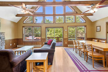 living room with many windows and two couches