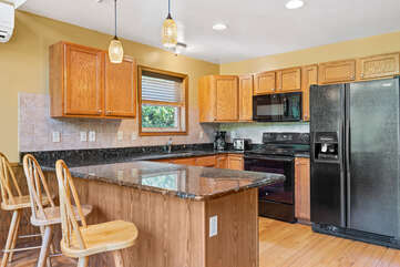 kitchen with fridge and nearby sink