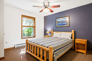 blue bedroom with single bed and ceiling fan