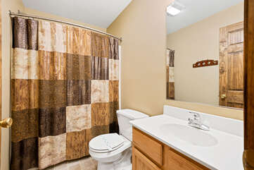tan bathroom with shower and sink