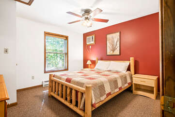 red bedroom with single bed and ceiling fan