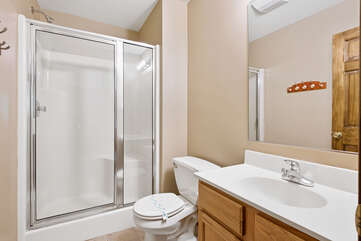 tan bedroom with walk-on shower and sink