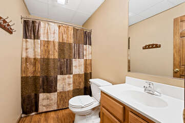 tan bedroom with shower and nearby sink