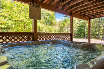 hot tub underneath deck at a home for rent in lake harmony pa