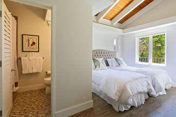 Poolside Palisade Bedroom with choice of a King bed or two Twin beds.  This room has a door to the balcony with access to the pool area.