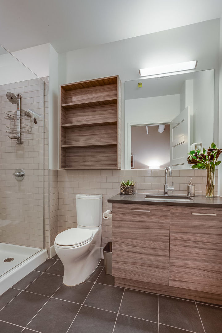 Walk-In Shower, Toilet, Single Vanity Sink, and Mirror.