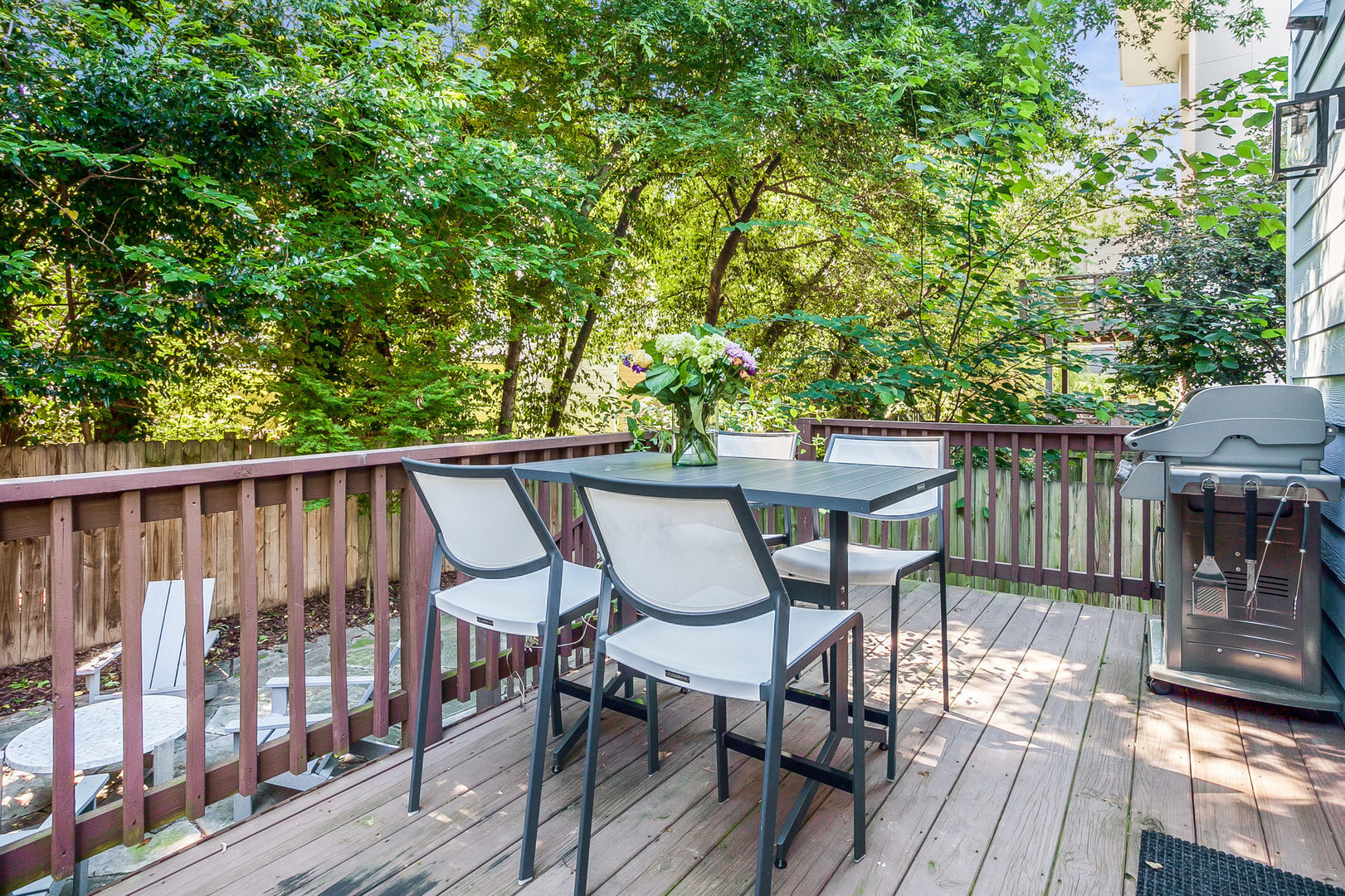 Outdoor Dining Table, Chairs, and BBQ Grill in the Backyard Deck.
