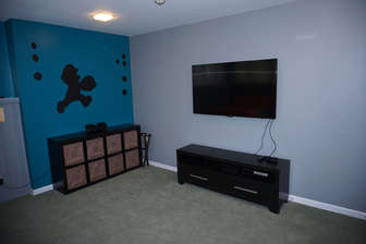 Bedroom 5 Features a Large TV and Video Games