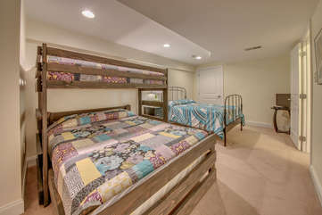 A bunk-bed and spare bed in one of the bedrooms of this Big Boulder rental.