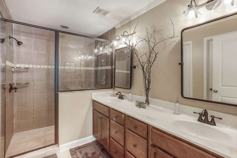 Double Vanity Sink, Walk-In Shower, Mirrors, and Lamps