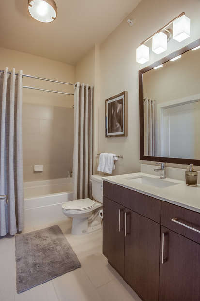 Guest Bathroom With Large Mirror