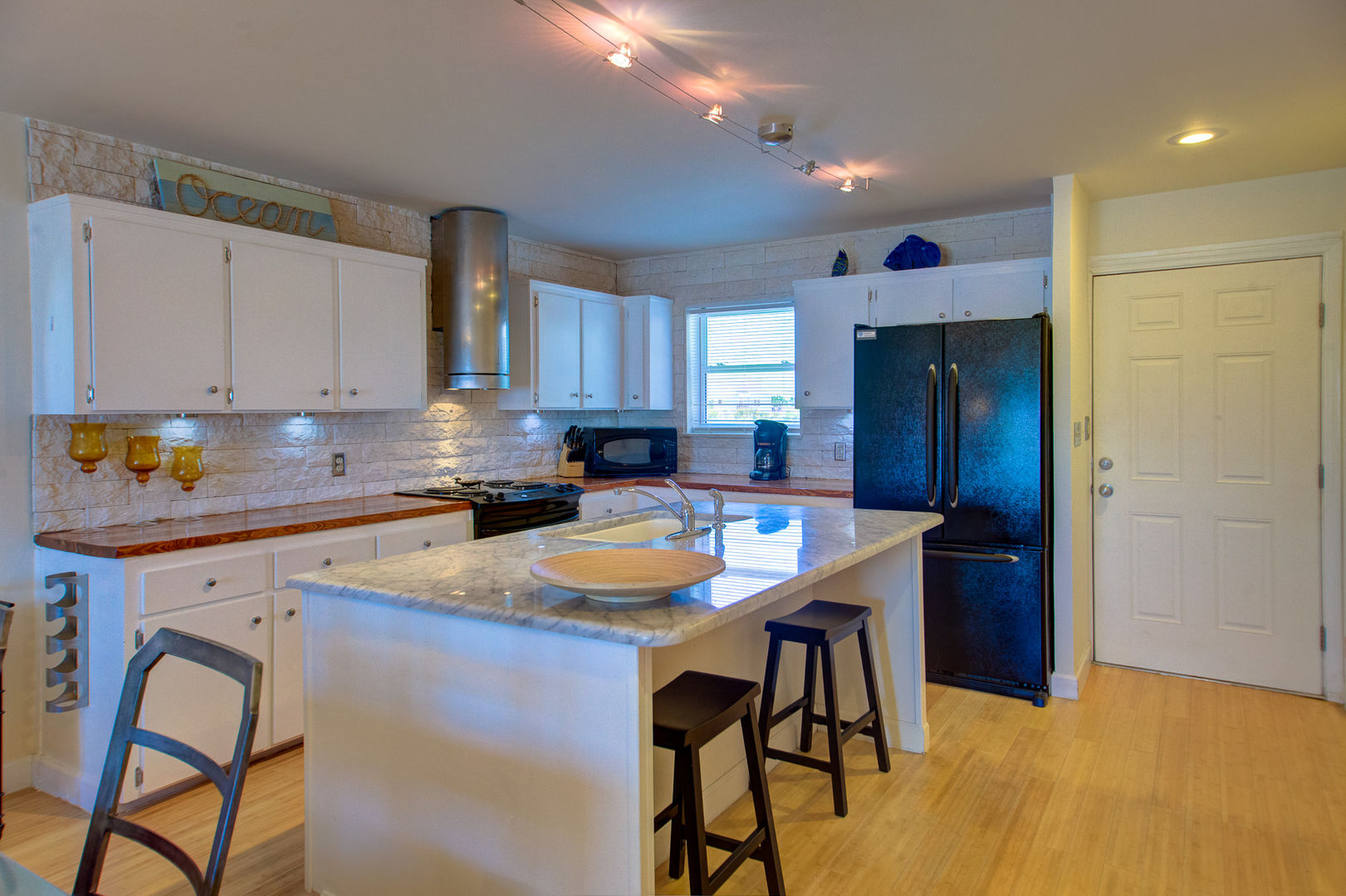 Bright Kitchen Features a Large Island.
