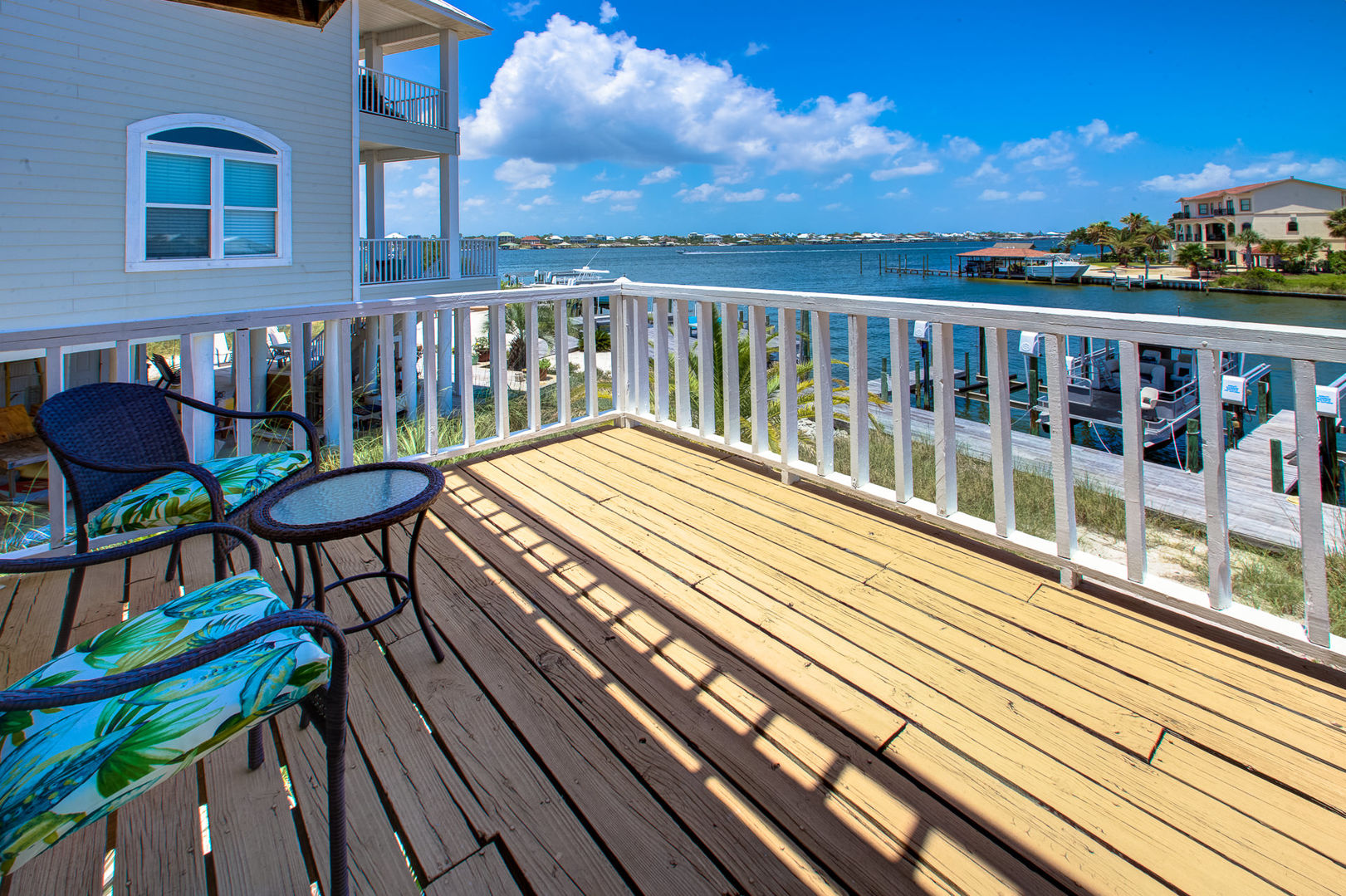 Relax on the Deck Attached to Vacation Rental in Pensacola Florida.