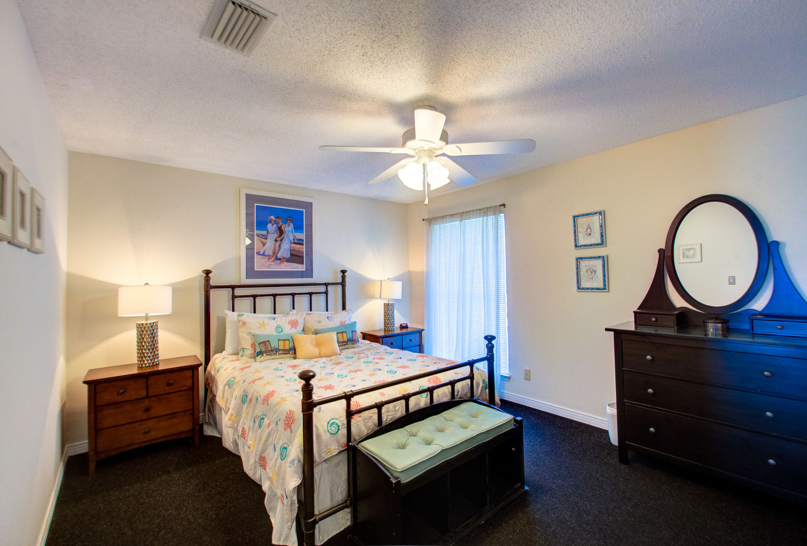 Bedroom Features Two Side Table and Dresser.