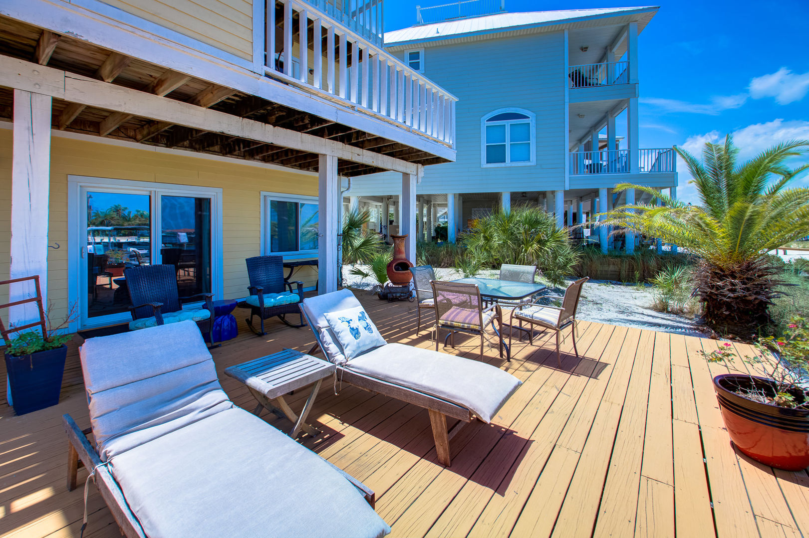 Lounge Chairs Seated on Deck of Vacation Rental in Pensacola Florida.