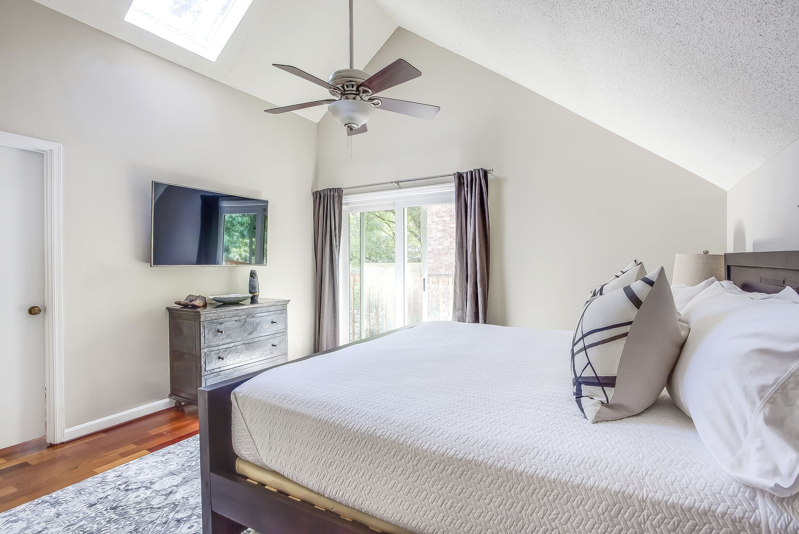 This Poncey Highlands Rental has a master bedroom with TV and sliding class door