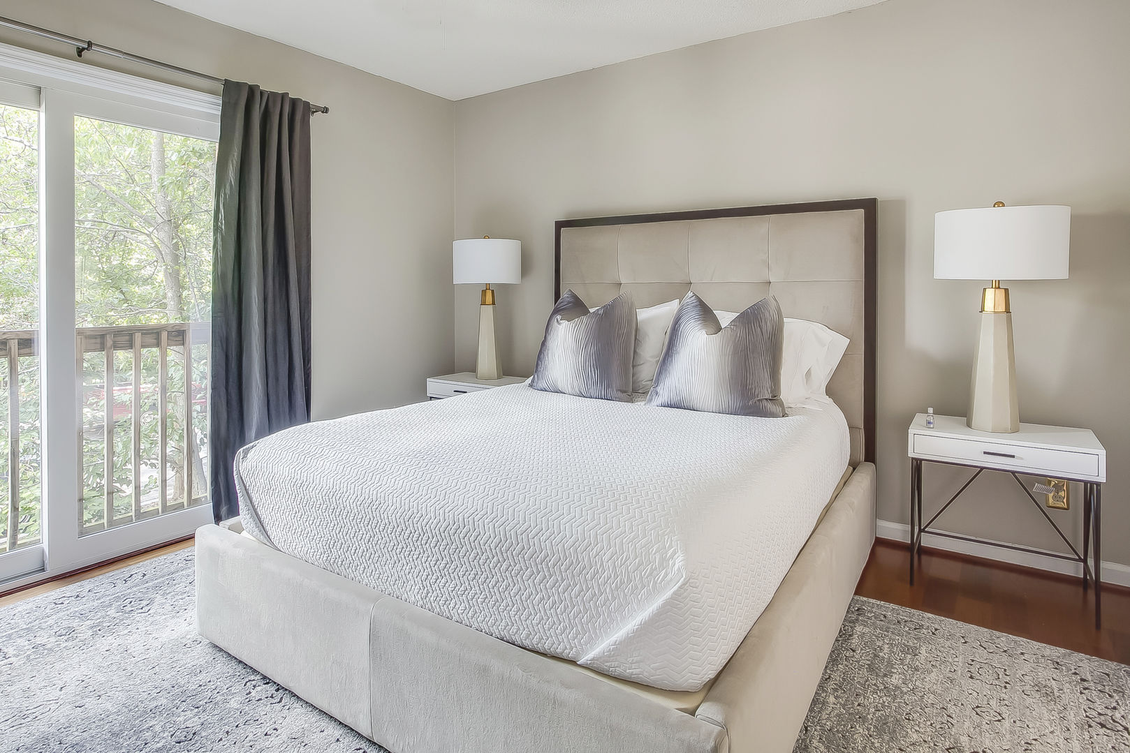 Guest bedroom in this Poncey Highlands Rental with door to patio