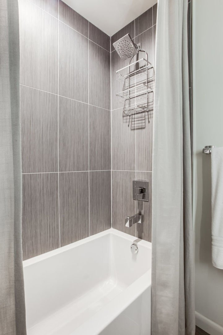 Shower-Tub Combination with Curtain.