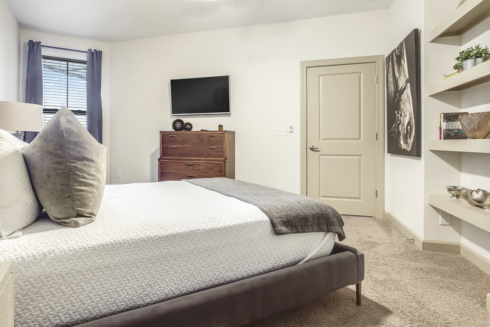 Bedroom with wall mounted TV