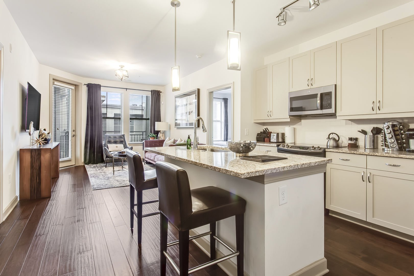 This Atlanta Rental Apartment has a kitchen area with bar-style seating
