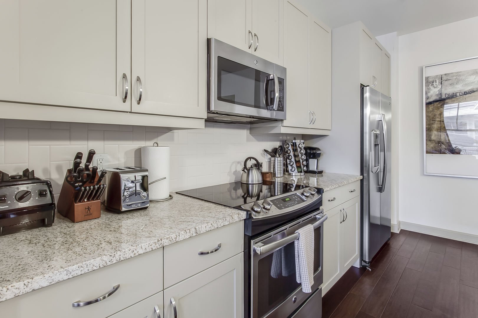 This Atlanta Rental Apartment has a kitchen area with stove and microwave