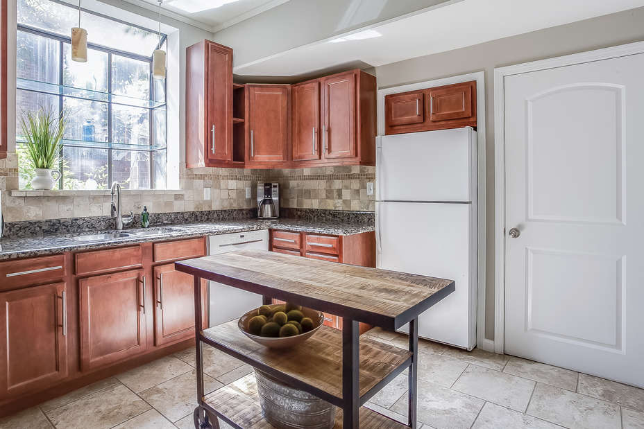 Kitchen in this Poncey Highlands Rental with sink and refrigerator