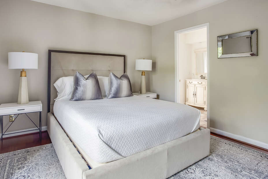 This Poncey Highlands Rental features a guest bedroom with nearby bathroom