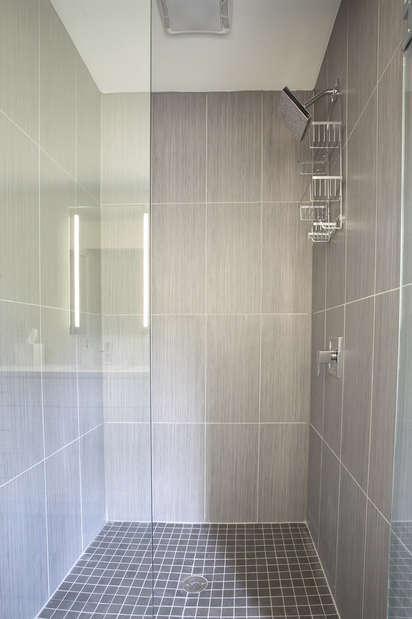 Walk-In Shower with Glass Door.