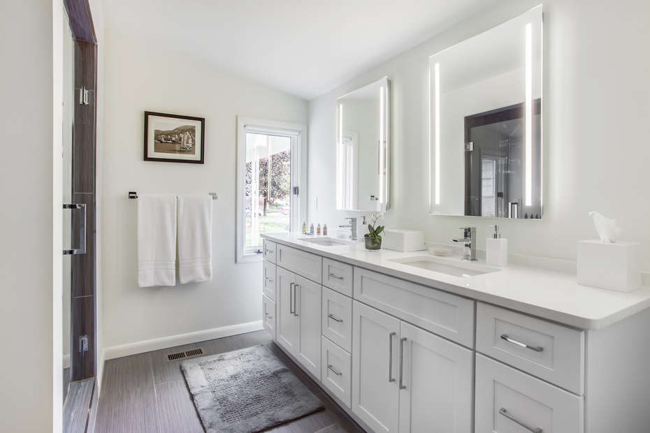 Double Vanity Sink, Mirrors, and Walk-In Shower.