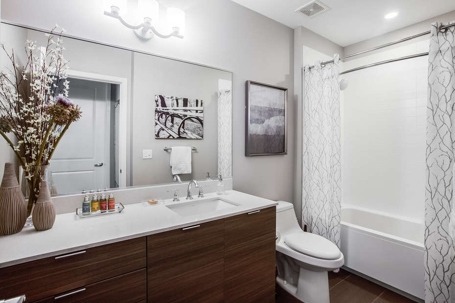 Guest Bathroom with Full Shower and Large Mirror