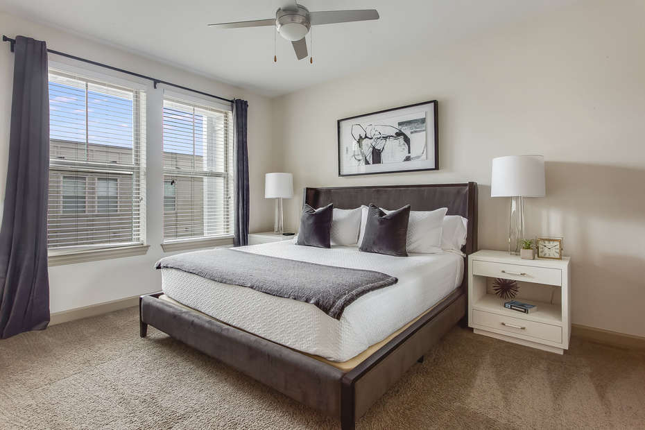 Bedroom at this Atlanta Rental Apartment with ceiling fan and nearby nightstand