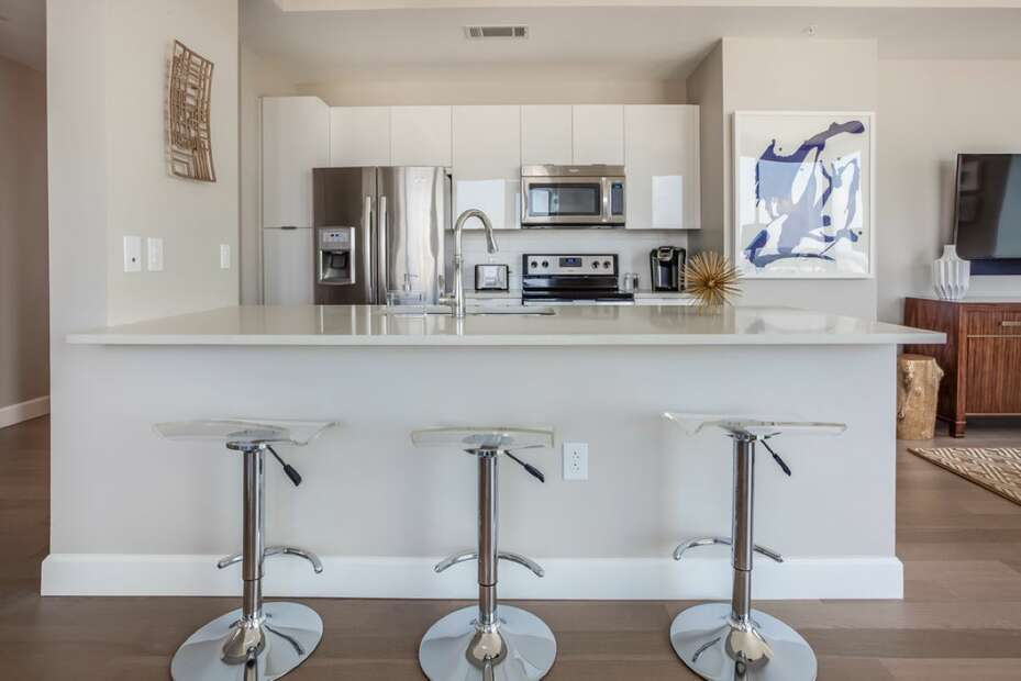 Fully Equipped Kitchen with Breakfast Bar seating for three