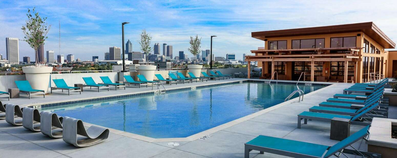 Rooftop Community Pool with Poolside Chairs.