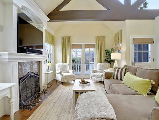 Open Living Room w/ Vaulted Ceilings & Access to Private Patio