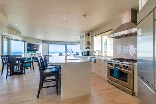 Kitchen with modern appliances and bar seating by the center island.