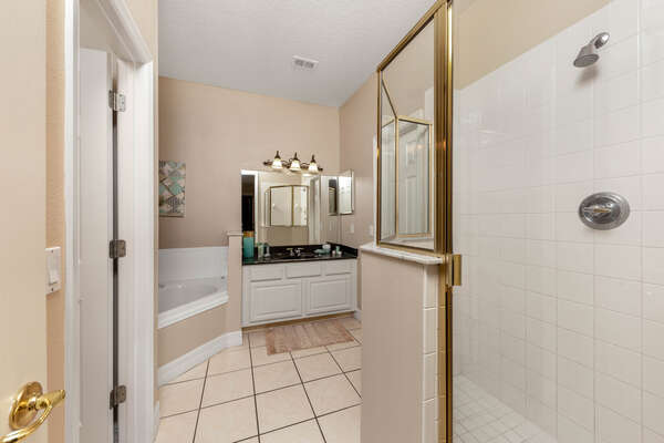 Luxury en-suite bathroom with a jacuzzi bath and walk-in shower