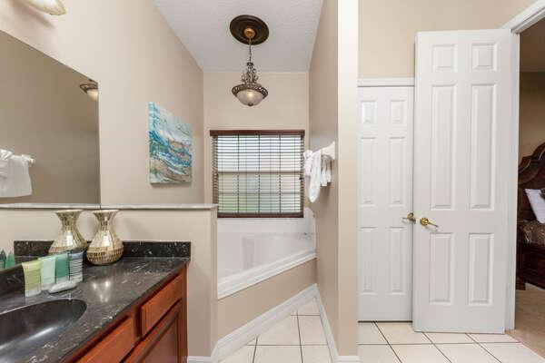 Luxury en-suite bathroom with a jacuzzi bath