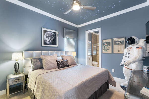 This out of this world bedroom is perfectly decorated with star lights built into the ceiling and a life size Astronaut