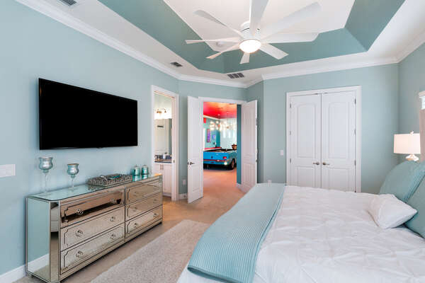 This bedroom has a 65 inch SMART TV