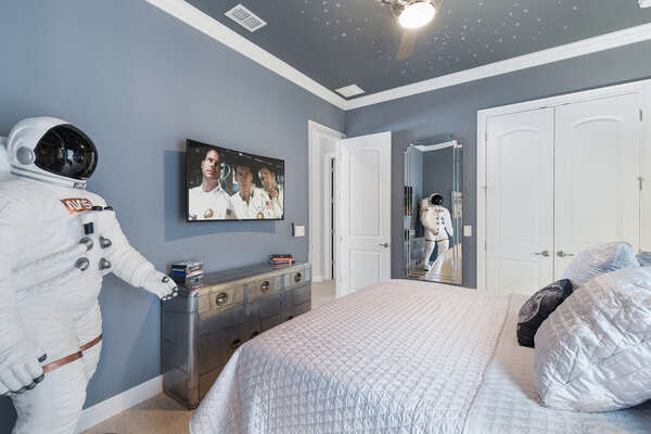 This bedroom has a 50 inch 4K curved SMART TV