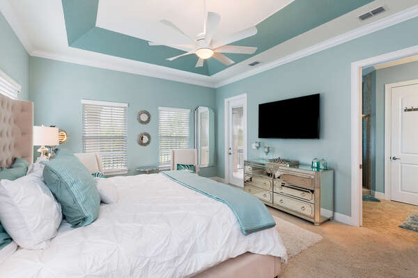 The master bedroom features a King size bed, en-suite bathroom, and private balcony with view to the pool area