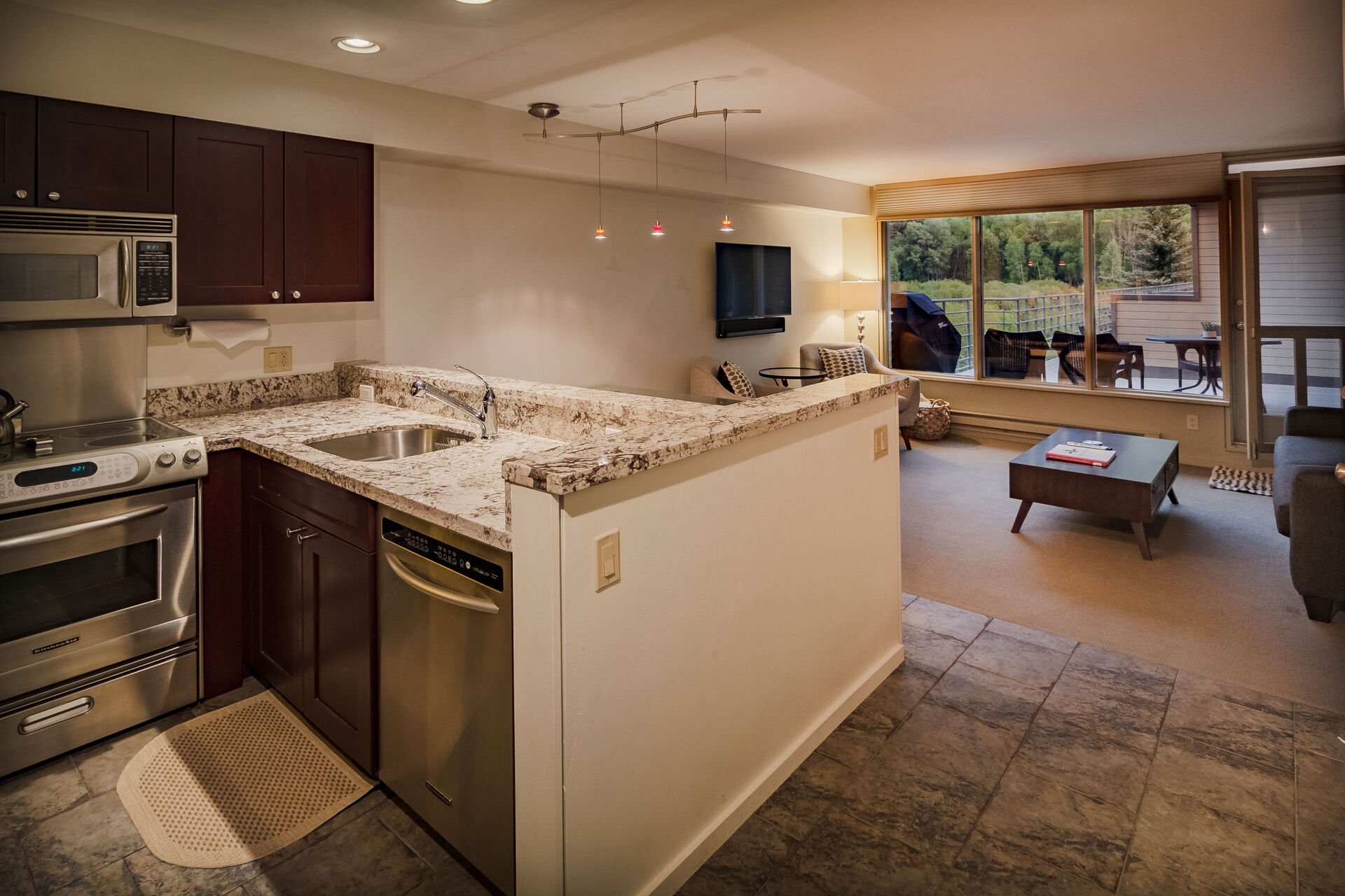 Marble counter in kitchen with sink.
