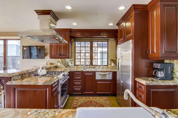 Kitchen Features Stainless Steel Appliances.