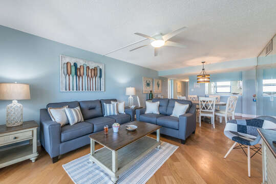 Spacious living & dining room with direct ocean views. Queen sofa sleeper & 65